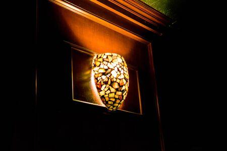 Ceiling light illuminates a dark bar, in New York City Reklamní fotografie