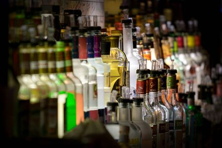 Rich assortment of alcoholic beverages, in a New York City bar
