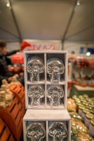 Shiny silver metal skulls being sold at a local market in Upstate New York Stock Photo
