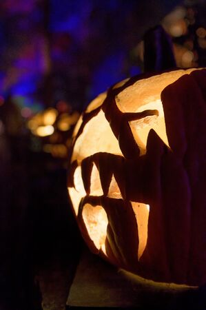 An illuminated carved pumpkin, ready for Halloween 写真素材
