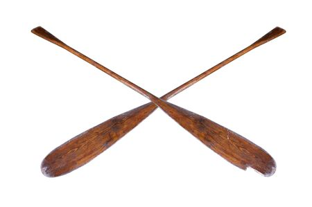 A pair of old, well-used, partially broken oars, isolated on a white background Stock Photo