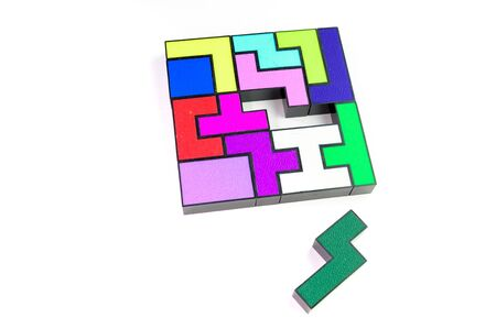 Multi-colored puzzle made of plastic blocks, thats missing a piece, isolated on a white background