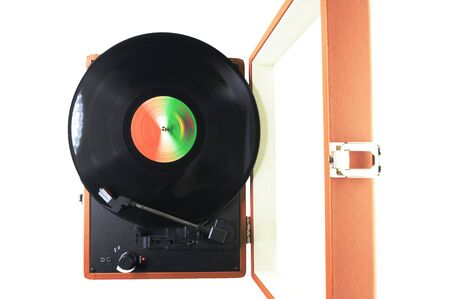 Top view of an old-fashioned suitcase record player and turntable with a spinning vinyl record, isolated on white background Archivio Fotografico