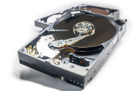 Old-fashioned, open, mechanical harddisc drives, isolated on a white background Banco de Imagens