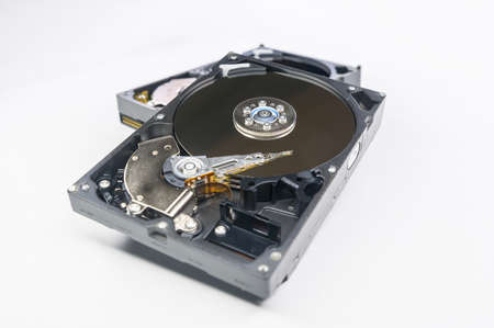 Old-fashioned, open, mechanical harddisc drive, isolated on a white background