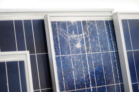 solarcell: A broken photovoltaic module with others  Stock Photo