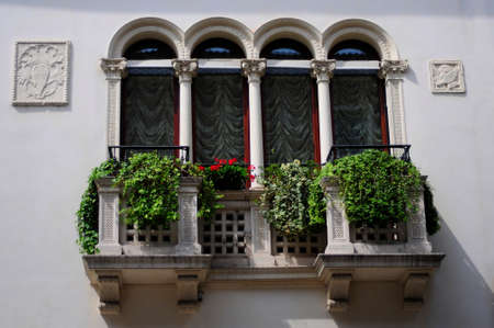 Elegant balcony with flowers and geraniums photo