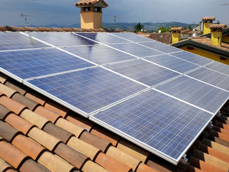 Photovoltaic system on a roofs house  Stock Photo