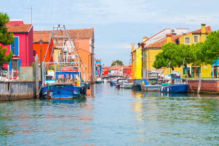 Buildings and canal in Burano, an island full of colors in the lagoon near Venice photo
