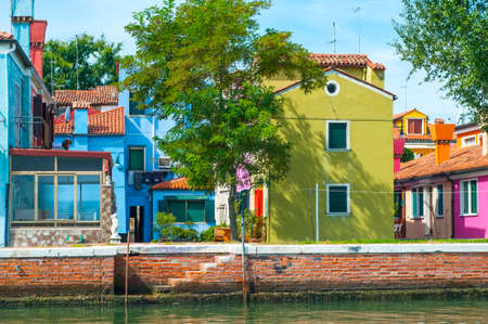 Buildings in Burano, an island full of colors in the lagoon near Venice photo