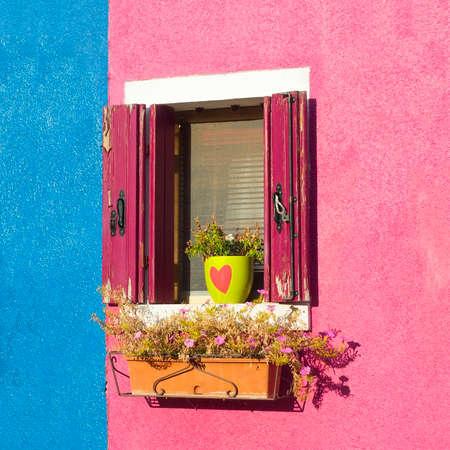 Balcony in Burano, an island full of colors in the lagoon near Venice photo
