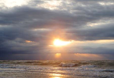 Sun rays of light between clouds photo