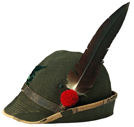 hat with feather: Old hat in the use of armed forces in the Italian alps Stock Photo