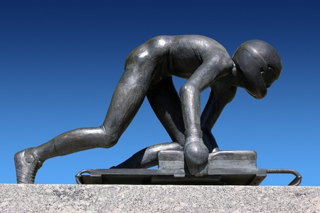 Bronze sculpture depicting the Olympic sport of Skeleton Editorial
