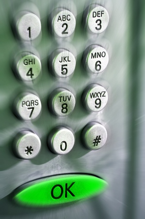 Keyboard of a public telephone with ok green button Stock Photo - 12036311