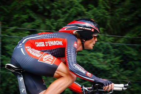 Athlete with helmet in the last stage of 15 km individual time trial (Tour of Italy 30 may 2010)