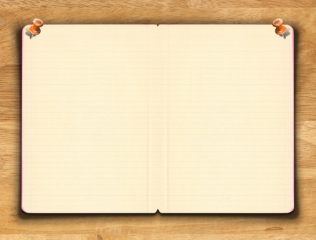 Blank notebook paper with line on the wooden background Standard-Bild