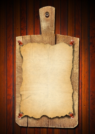 Notebooks for recipes or menu on used wooden cutting board  photo