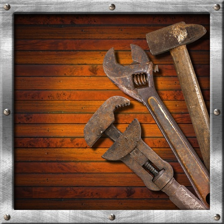 Wood and metal vintage background with old tools and space for text photo