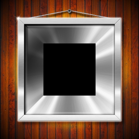 silver picture frame: Empty metallic frames on a old dark wooden wall