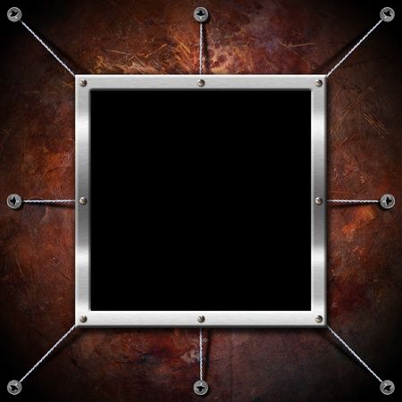 Empty metallic frame on a grunge brown background Stock Photo - 15077364