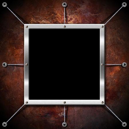 Empty metallic frame on a grunge brown background Stock Photo - 15077364
