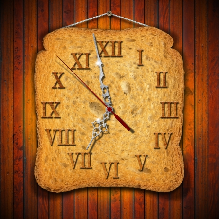 seven o'clock: Watch made with a rusk on wooden background
