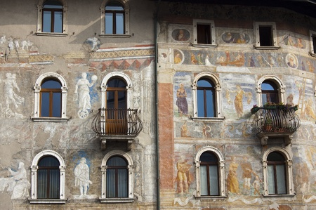 fresco: XIV-XV century - detailed frescoes in the cathedral square in Trento, Italy Stock Photo