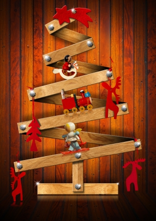 wooden horse: Stylized Christmas tree decorated with Christmas objects on wooden background