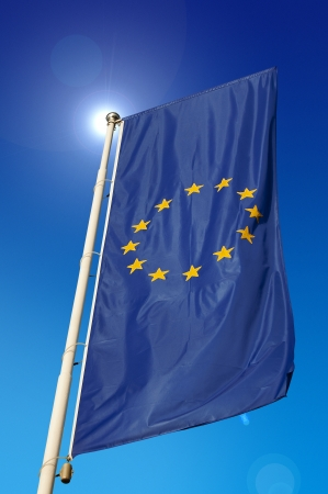 Vertical European Union flag, waving in the blue sky photo