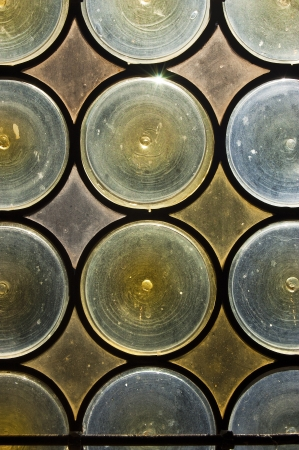 stained glass window: Old window with stained glass - opaque blue and yellow circles  Stock Photo