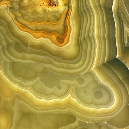 Magnified image details of a layer of onyx, green, yellow and orange photo