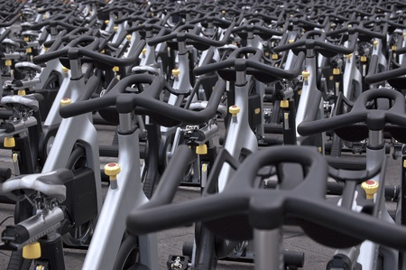Large group of aluminum spinning bikes outdoors  photo