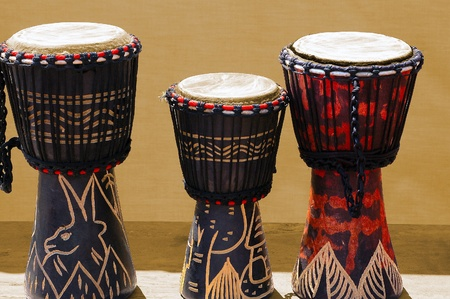 bongos: Three wooden and decorated African bongos, African art  Stock Photo