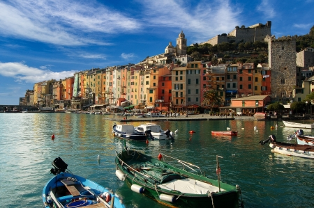 The harbor with small boats and colorful houses of Portovenere in Liguria Italy photo