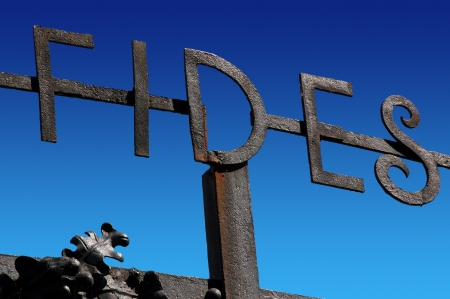 Wrought iron sign with the inscription FIDES on blue sky Stock Photo - 16246451