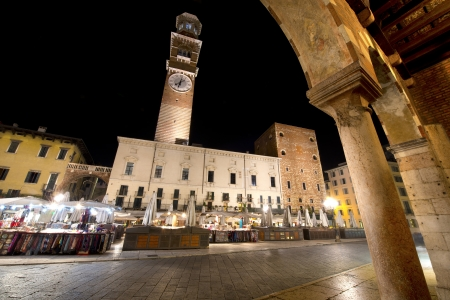 Piazza delle Erbe by night and medieval tower of the Lamberti in Verone - Italy Stock Photo - 16376685