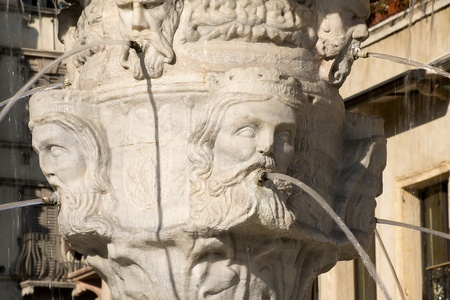 Detail of the fountain of Madonna Verona with heads of kings in Verona - Italy photo