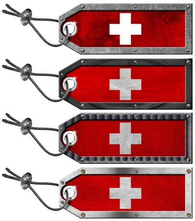 Four grunge metallic tags with Swiss flags, steel cable and metal rivets