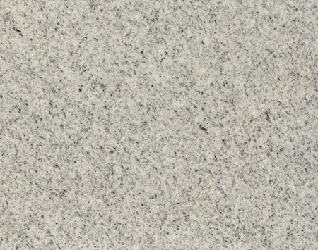 Surface of the granite with white, gray and black tint for background photo