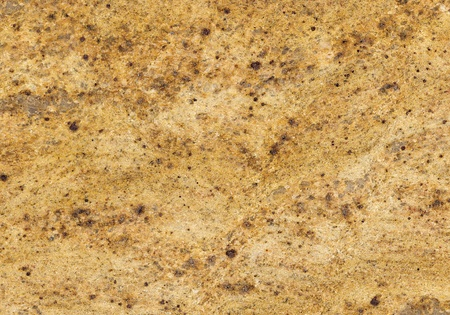 Surface of the granite with yellow, gold and brown tint for background photo