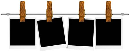 Four blank photos hanging on a steel pole with large clothespin  photo