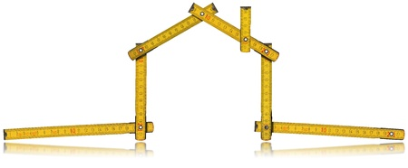 adjusted: Wooden yellow meter tool forming a house with reflection on white background
