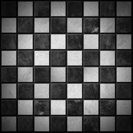 desk toy: Empty metallic chessboard with dark and light gray squares  Stock Photo