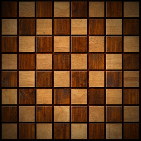 Empty wooden chessboard with dark and light brown squares  photo