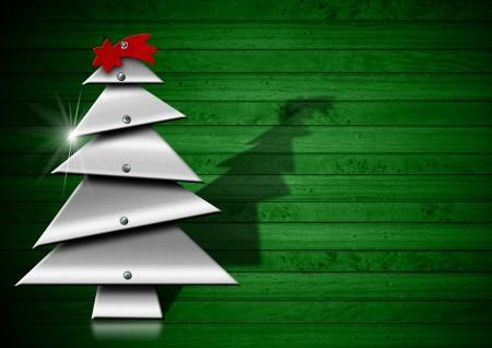 lamina: Metallic Merry Christmas tree with screws heads on green wood background