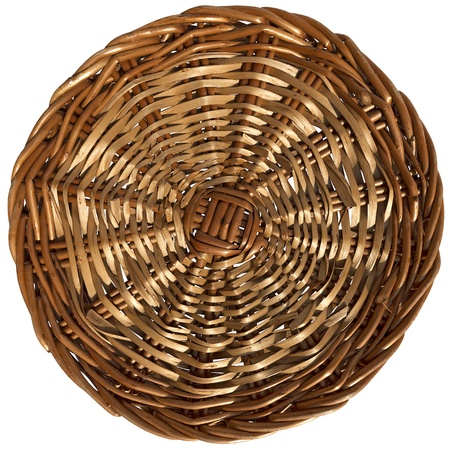 Circular background with woven wicker on a white background  photo