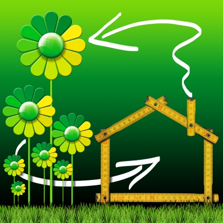 ecologic: Wooden yellow meter tool forming a ecologic house with green stylized flowers and grass Stock Photo