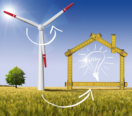 Wooden yellow meter tool forming a ecologic house with wind energy turbine power station Stock Photo - 20962425