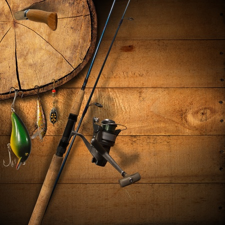 fishing lure: Wooden background with fishing tackle and knife